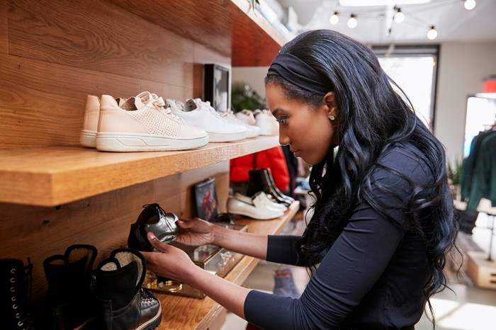 A woman shops for shoes.