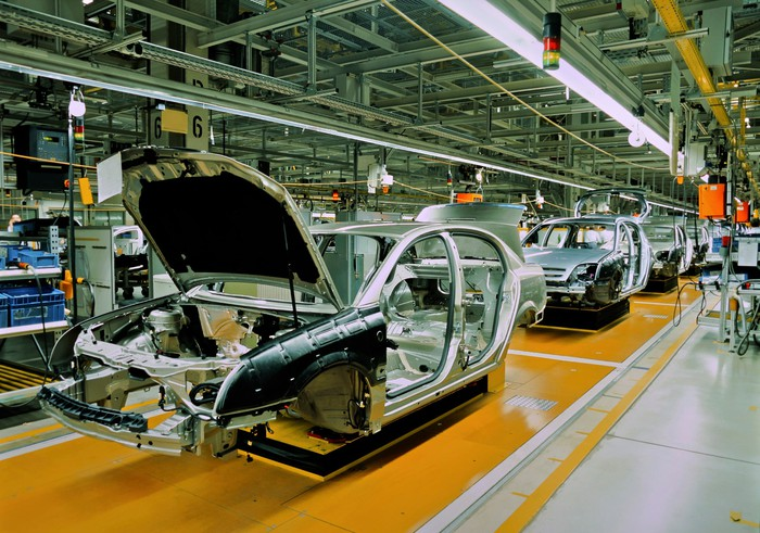 auto assembly plant showing car bodies lined up on assembly line