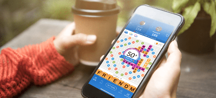 A person playing Zynga's 'Words With Friends' on a mobile phone.