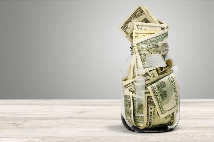 Cash stuffed inside a glass jar