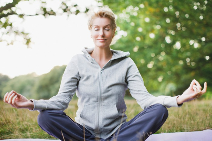 Woman sitting outdoors meditating