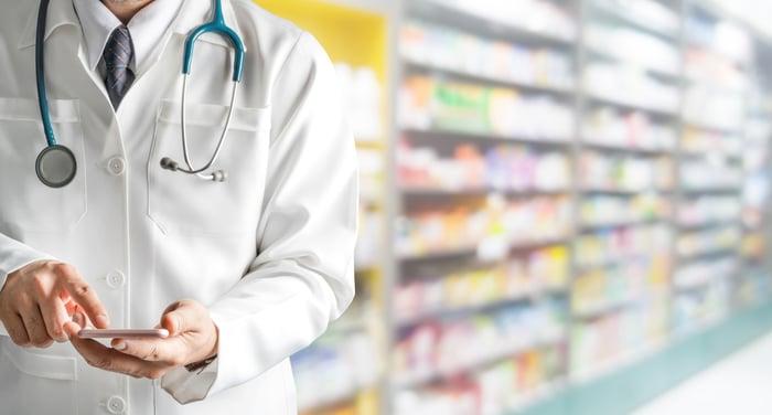 Doctor standing inside a pharmacy.