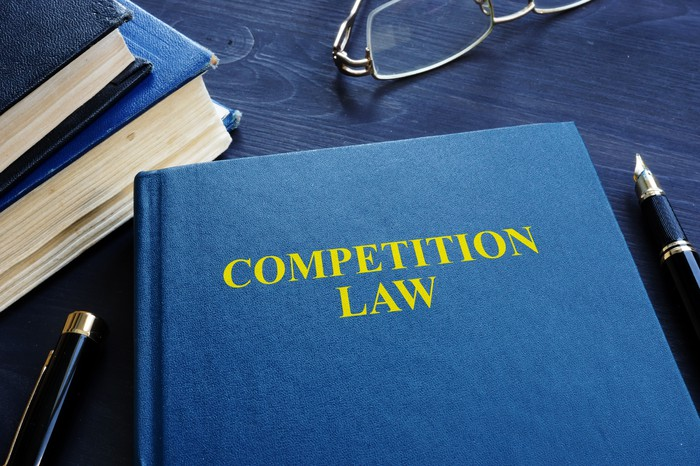 Blue text book with Competition Laws written on the over in yellow.