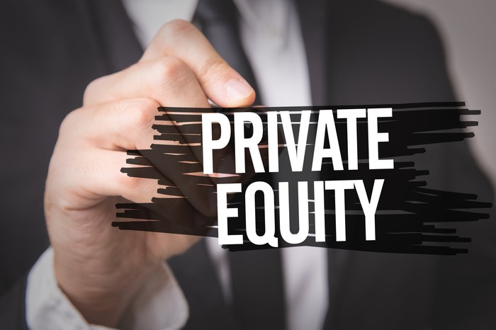 "Man writing the words ""Private Equity"""
