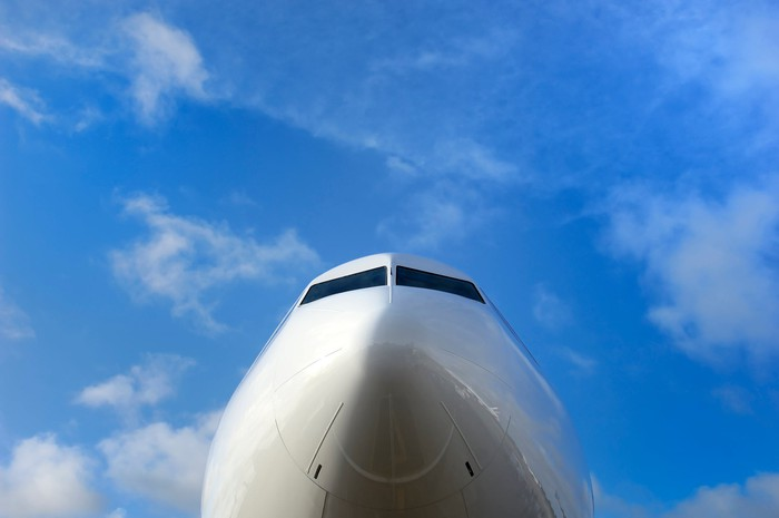 The nose of a jet with a bright blue sky in the background