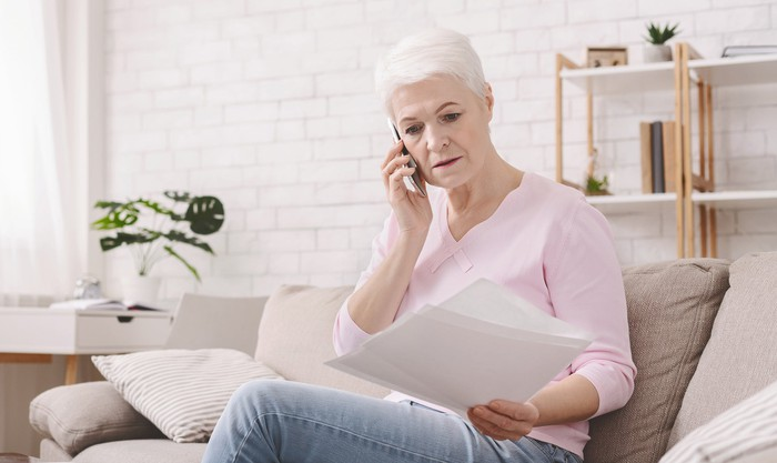Older woman upset about money.