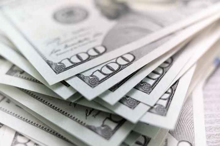A messy stack of hundred-dollar bills.