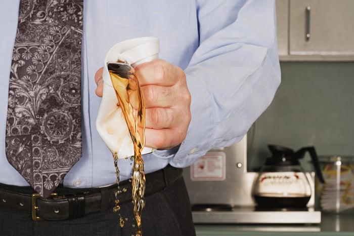 Man crushing coffee cup