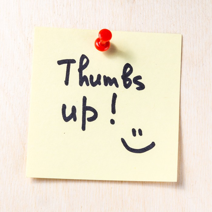 A sticky note saying Thumbs Up.