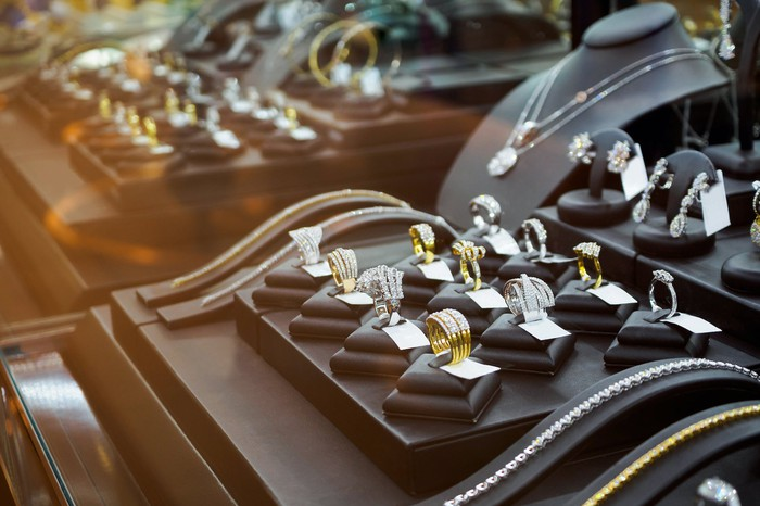 A selection of rings in a jewelry-store display case.