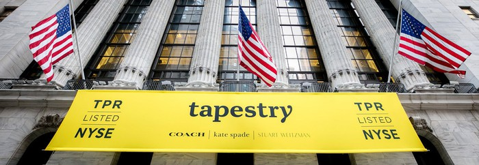 A banner with Tapestry's logos and brand names hanging on the front of the New York Stock Exchange.