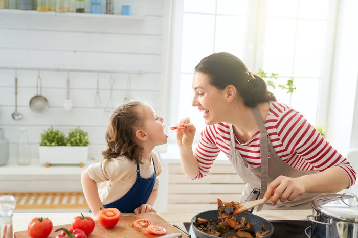 A mother and daughter cooking together.
