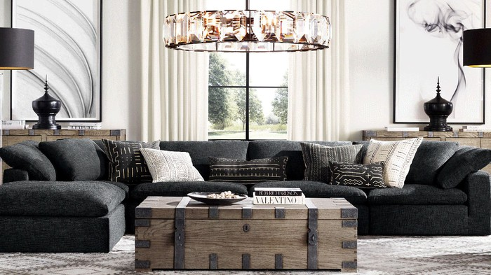 A living room arrangement from RH with sofa, coffee table, chandelier, and other decor.
