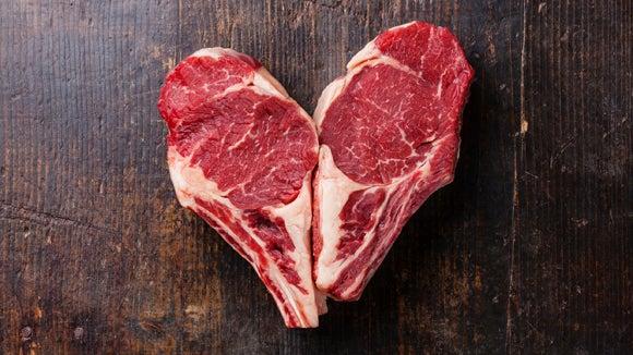 Two ribeye steaks in a heart shape