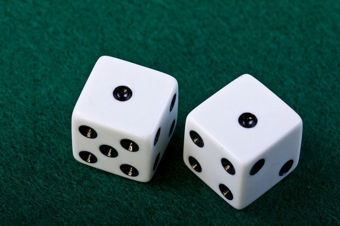 Pair of dice showing two ones.