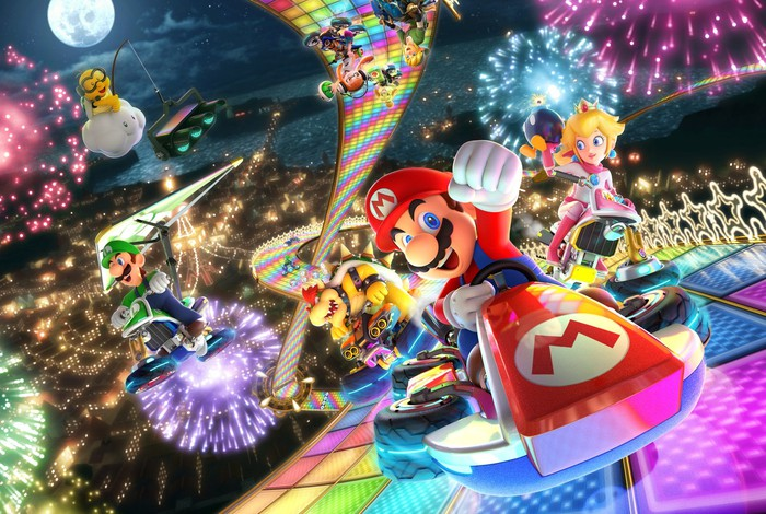 Game art for Nintendo's Mario Kart game, with in-game characters racing each other with colorful fireworks and special effects in the background.