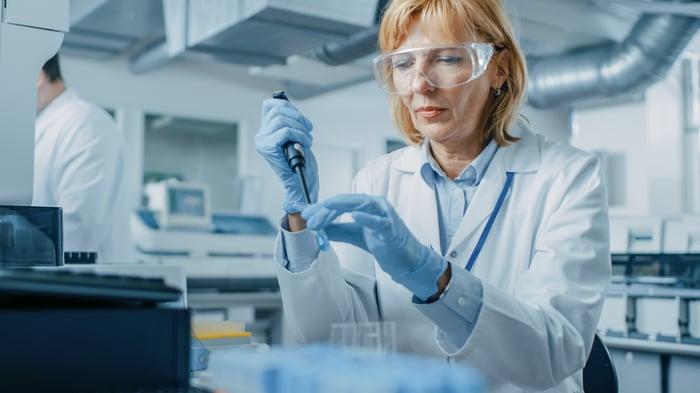 A researcher works in a biotech lab.