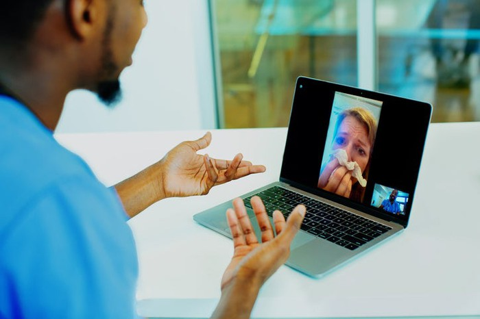 A patient communicating with a healthcare professional during a telemedicine session.