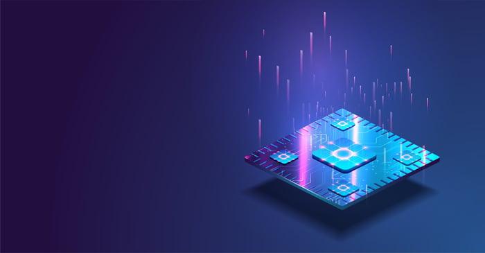 A square  semiconducto chip in purple blue light.