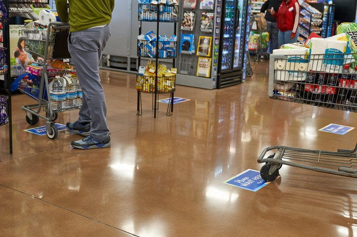 Social distancing decals on the floor of a Kroger store.