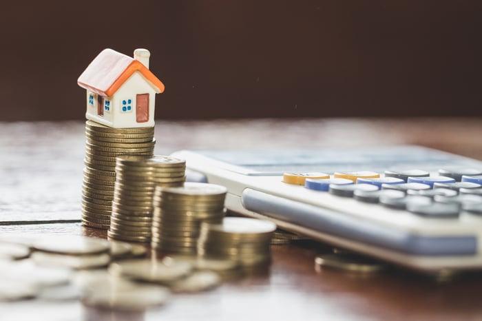 Coins, a calculator and a house
