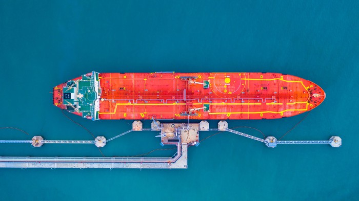 An oil tanker docked and being filled