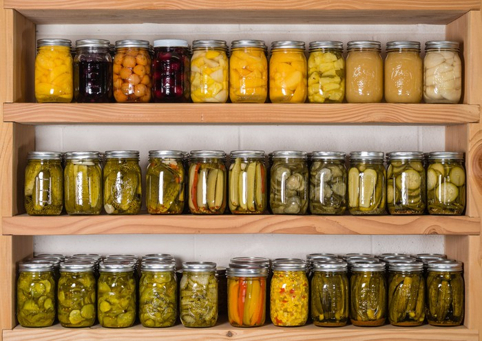 Shelves stocked with jars of homemade canned foods.
