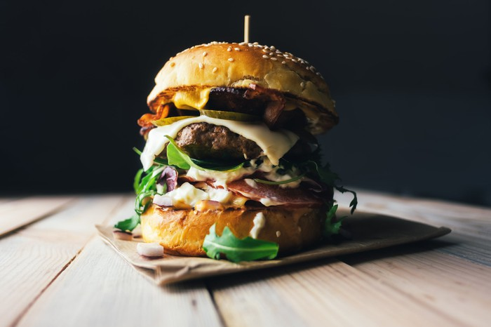Gourmet cheeseburger with multiple toppings