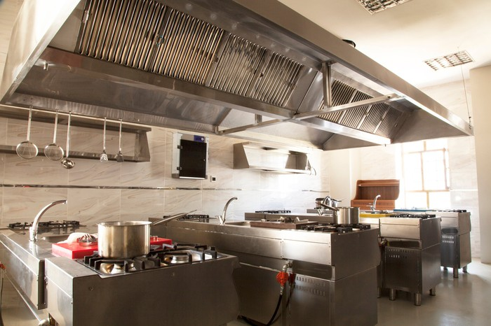 An empty commercial kitchen full of high-end equipment.
