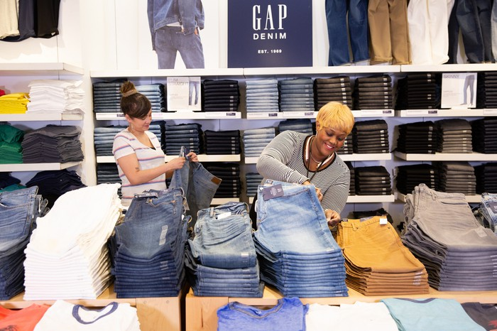 Gap sales associate folding jeans.