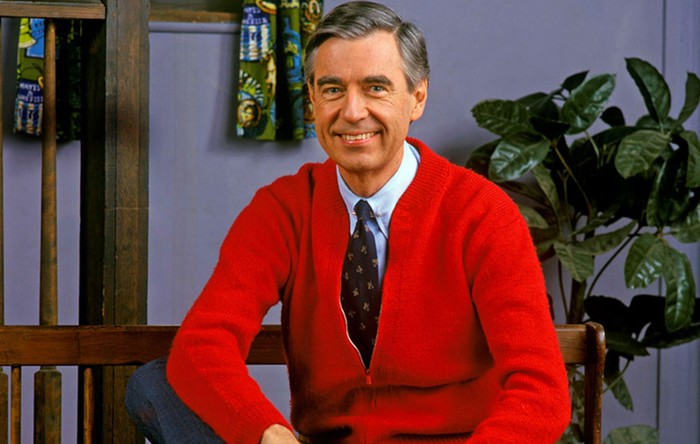Mr. Rogers in his trademark red cardigan sweater