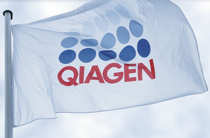 The Qiagen logo on a white flag