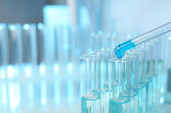 Dropper filling vials in lab
