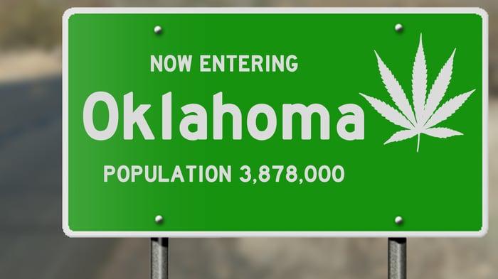 Oklahoma road sign with marijuana leaf.