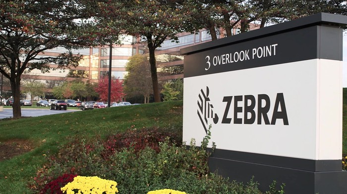 Photo of a painted wall outside Zebra's headquarters in Lincolnshire, IL, featuring the company logo in black and white.