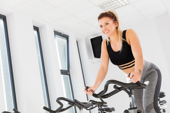 Woman exercising on a stationary bike