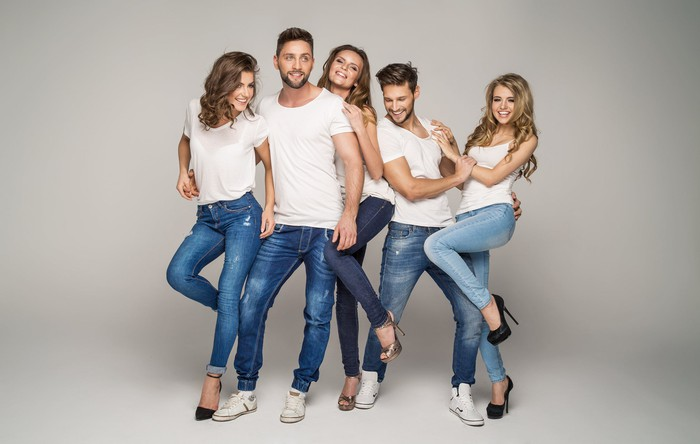 A group of young people in white t-shirts and jeans.