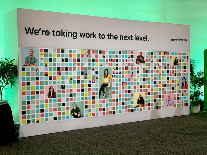 A mural featuring different employees at the ServiceNow headquarters