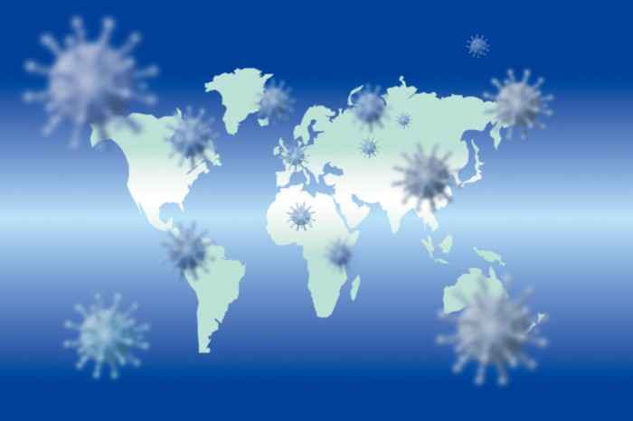 World map with virus particles superimposed