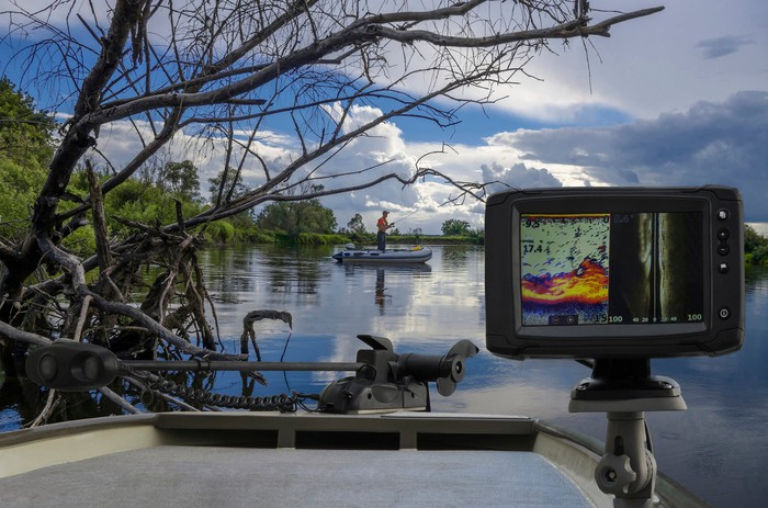 fishfinder on front of boat on river