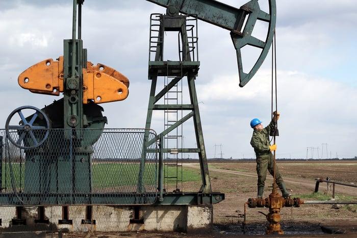 Oil worker on a pumpjack.