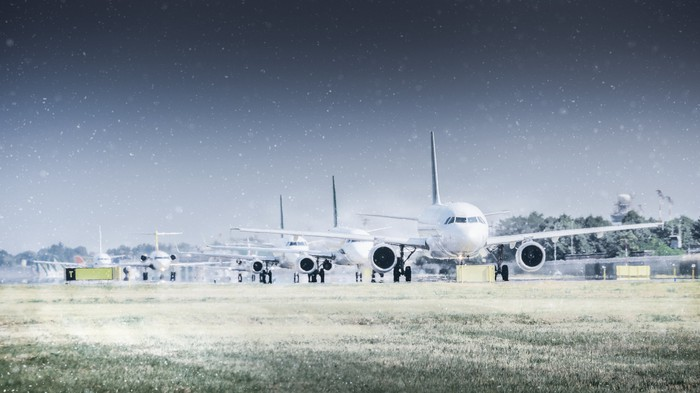 Row of airplanes on the ground