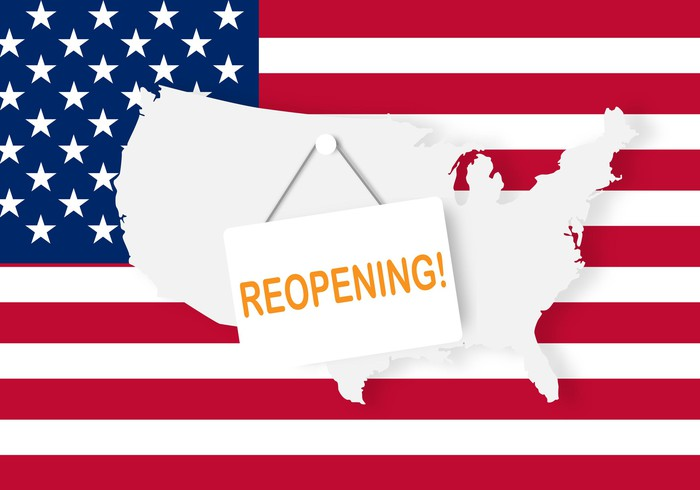 "U.S. flag and map with a sign saying ""reopening!"" hanging from the map."
