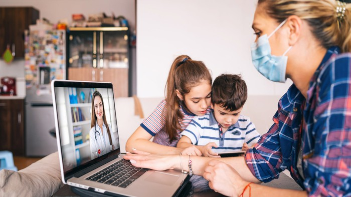 A family uses telehealth services