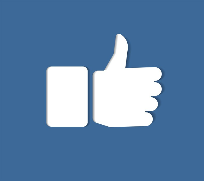 A thumbs up symbol, representing a key feature of Facebook.