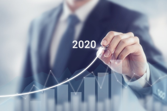 Businessman drawing a chart of growing success in 2020.