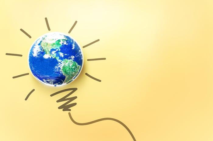 An illustration of the Earth illuminated like a light bulb.