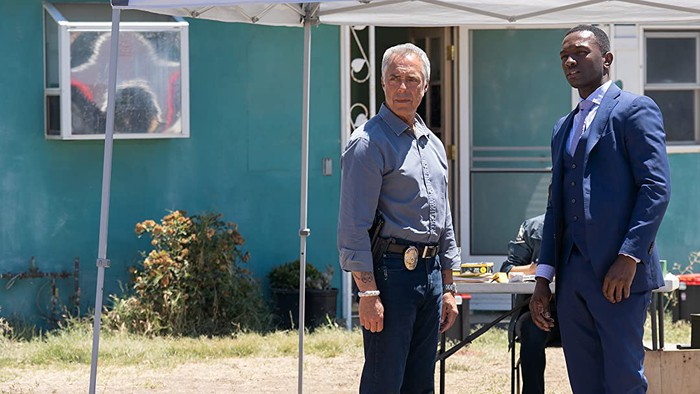 """Two detectives staring off screen on the set of """"Bosch"""""""