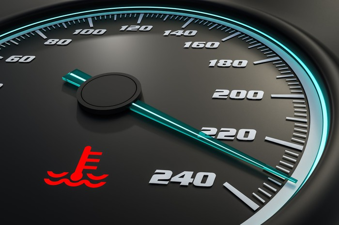 Engine temperature gauge with needle nearly at the maximum temperature
