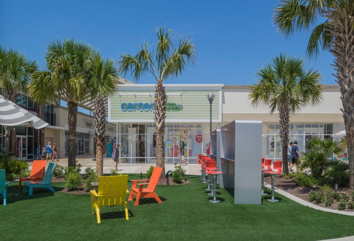 Outdoor area of a Tanger outlet mall.